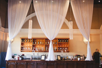 Chiffon Drapery Bar Treatment with Square Bead Chandeliers